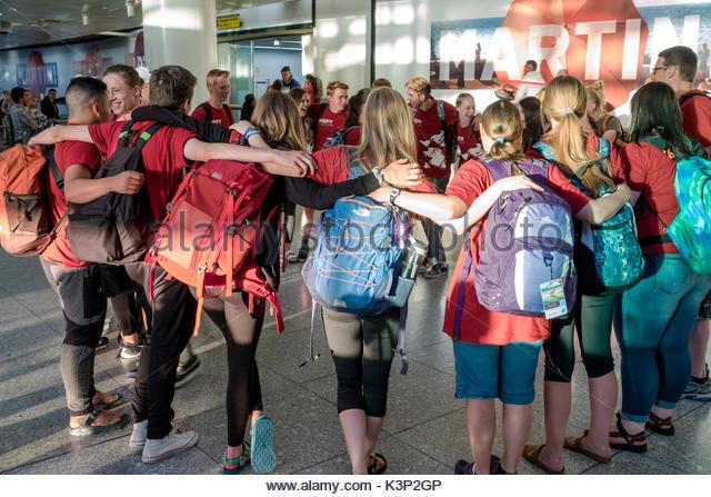 Lisbon Portugal Humberto Delgado Airport LIS Portela Airport terminal student boy girl teen embracing circle - Stock Image
