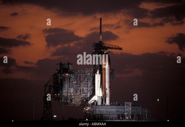 Kennedy Space Center Florida Space Shuttle on launch pad orange sky twilight usa united states - Stock Image