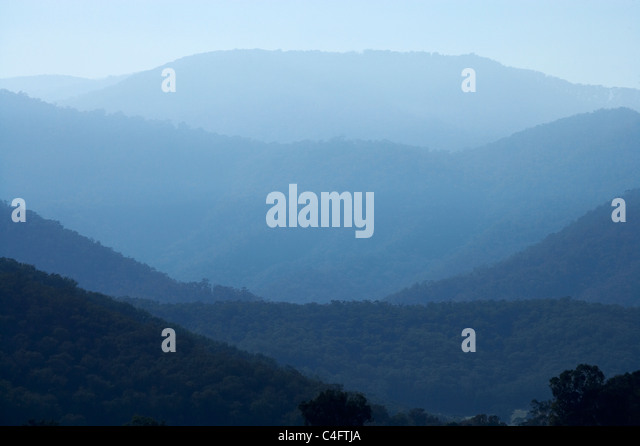 Smoky haze from burnoffs in the hills around Khancoban, Snowy Mountains, New South Wales, Australia - Stock Image