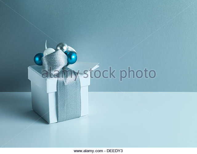 Christmas gift with silver ribbon and wrapping - Stock Image