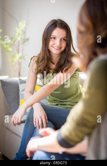 Woman discussing with a teenager. - Stock Image