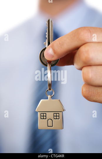 Real estate agent giving house keys - Stock Image