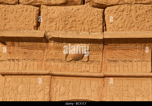 Egypt Kom Ombo temple walls carvings hieroglyphs winged solar disk - Stock Image