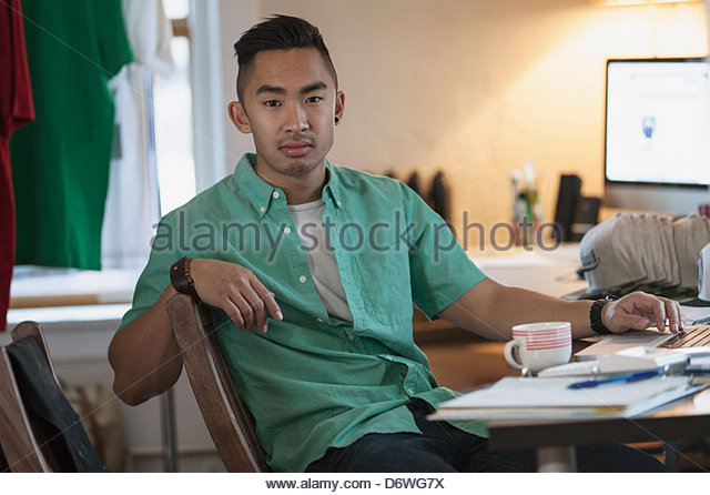 Portrait of male design professional at desk - Stock Image