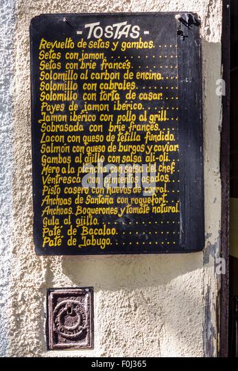 Madrid Spain Europe Spanish Centro Lavapias Calle Argumosa Casa de la Tostas restaurant menu board - Stock Image