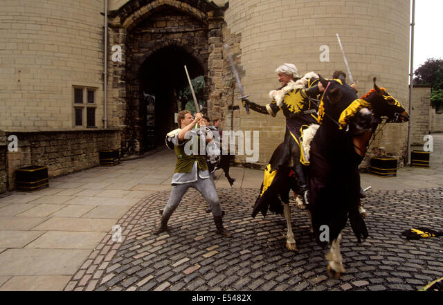 UK, England, Nottingham, Sheriff of Nottingham's men played by actors in swordfight outside Nottingham Castle - Stock Image