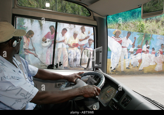 BVI Tortola Road Town Black male tour guide mural driving speaking - Stock Image