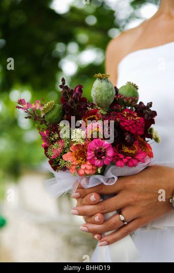 A bride holding a wedding bouquet, Sweden. - Stock-Bilder