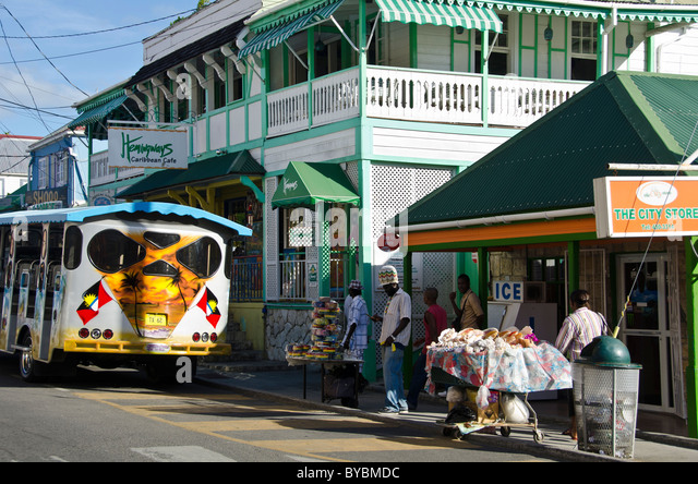 Redcliffe Quay shopping area, bus and people St Johns Antigua - Stock Image