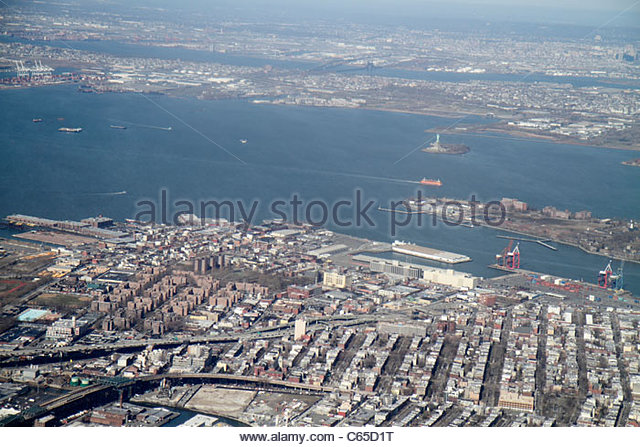 New York New York City NYC LaGuardia Airport aerial American Airlines aircraft arriving flight window seat view - Stock Image