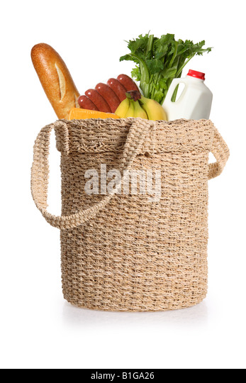 Grocery food items in an environmentally friendly reusable shopping bag - Stock Image
