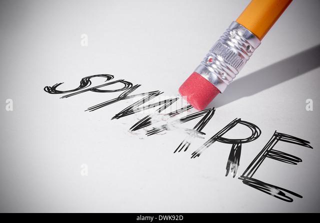Pencil erasing the word Spyware - Stock Image