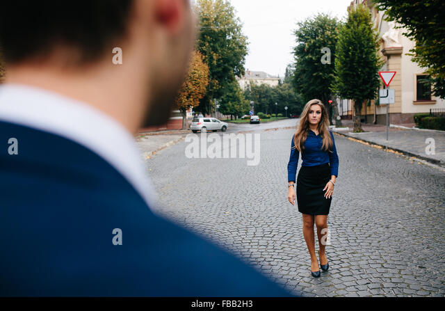 girl standing near the guy - Stock Image