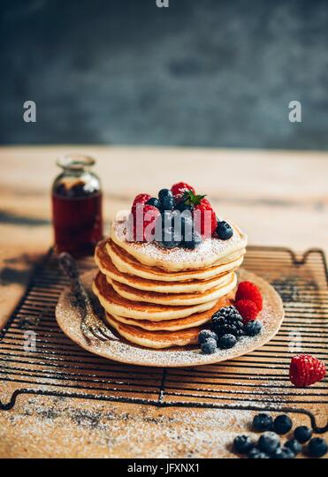 pancakes with blueberries & raspberries - Stock Image