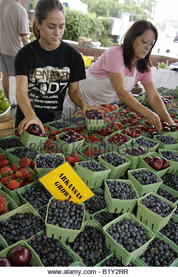 Little Rock Arkansas River Market Farmers Market locally grown produce buyers sellers woman teen girl fruit blueberry - Stock Image