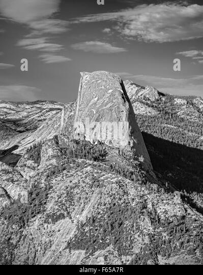 Black and white Half Dome rock formation, famous rock climbers destination, Yosemite National Park, USA. - Stock Image