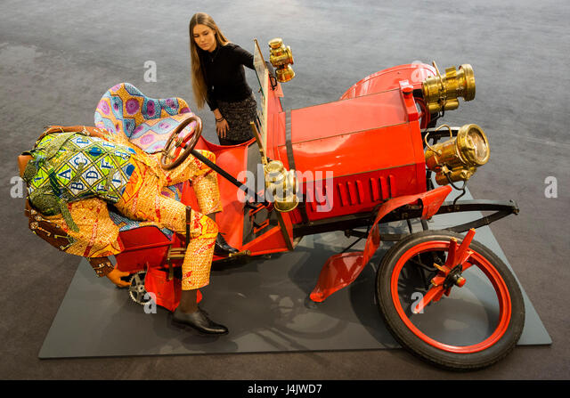 London, UK. 12 May 2017. A Sotheby's employee checks out Yinka Shonibare's artwork Crash Willy, 2009, est. - Stock Image