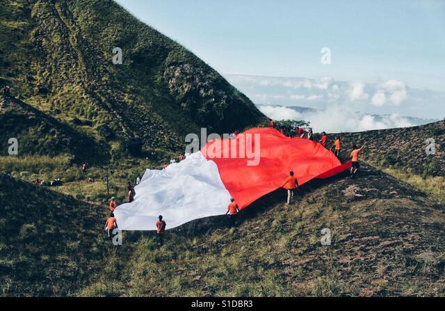 Indonesian Flag in batur volcano - Stock-Bilder