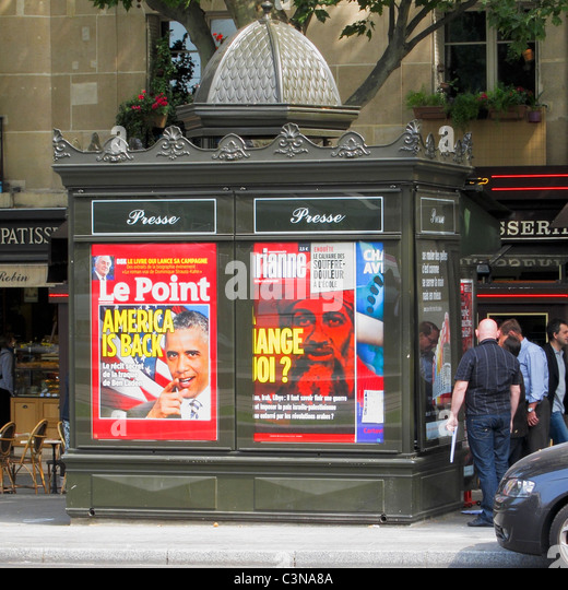 Paris, France, French Advertising on News kiosk on Street, Obama Magazine Cover - Stock Image