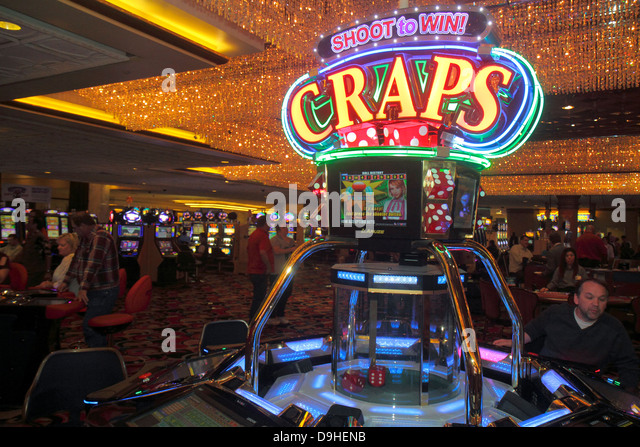 Nevada Las Vegas Las Vegas Hotel & Casino LVH slot machines machine gamblers gambling man craps - Stock Image