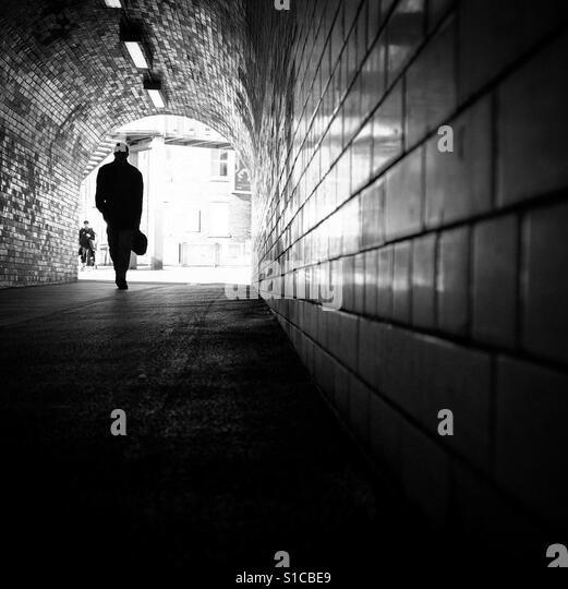 Man Walking through a subway, York, Yorkshire, England. - Stock-Bilder