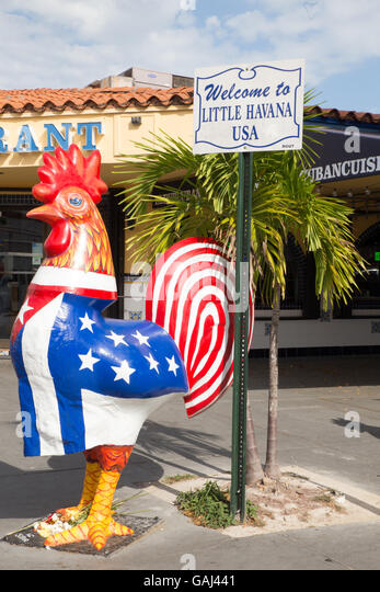 MIAMI, FLORIDA - APRIL 25, 2016: Colorful rooster statue along Calle Ocho in the Little Havana section of Miami. - Stock Image
