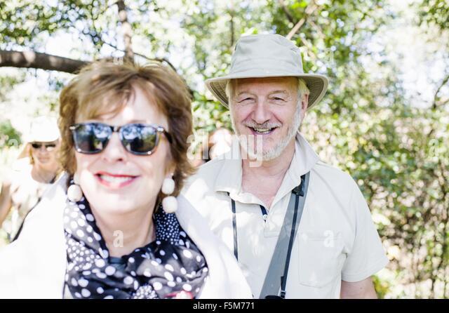 Portrait of senior man and wife on safari in Zambia - Stock Image