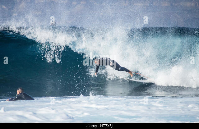Las Palmas, Gran Canaria, Canary Islands, Spain. 8th March 2017. Weather: 25 degrees Celcius and huge waves as Bodyboarders - Stock Image