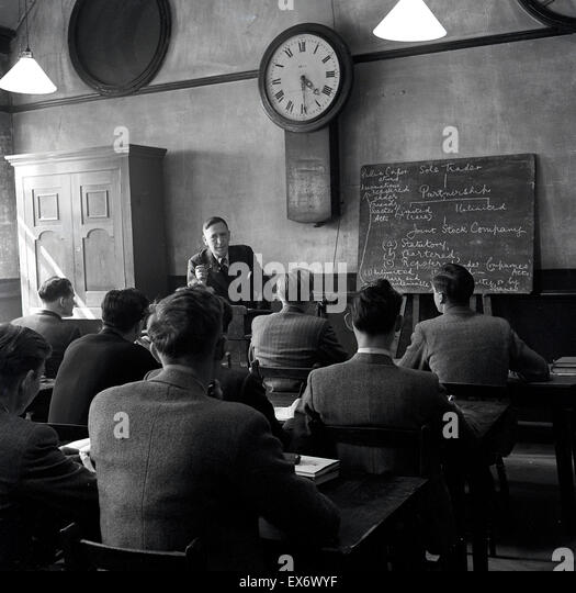 Historical, 1950s, group of male students in classroom being taught. - Stock Image