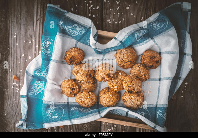 Oatmeal cookies on a towel on the wooden table horizontal - Stock Image