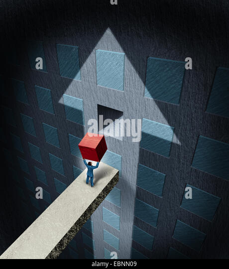 Financial success concept as a businessman lifting a heavy red cube to complete a wall puzzle shaped as an upwards - Stock-Bilder