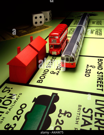 London Transport and Monopoly Board Monopoly and routemaster bus with underground train on Bond Street next stop - Stock Image