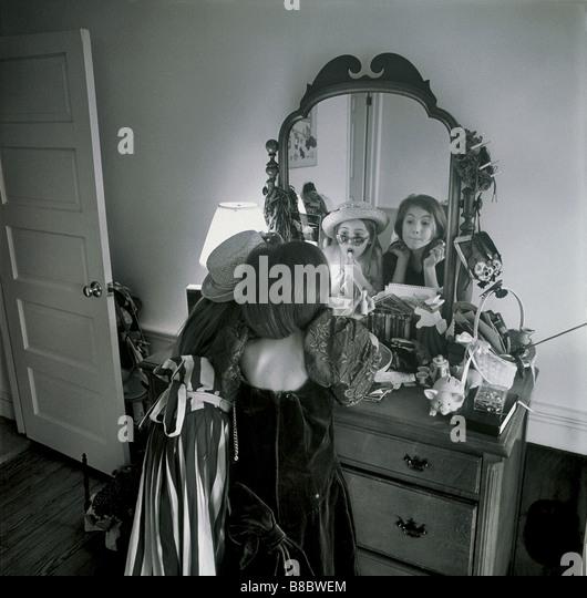FL4881, Nick Kelsh; Two Young Girls Playing Dress-up   Mirror, BW - Stock-Bilder