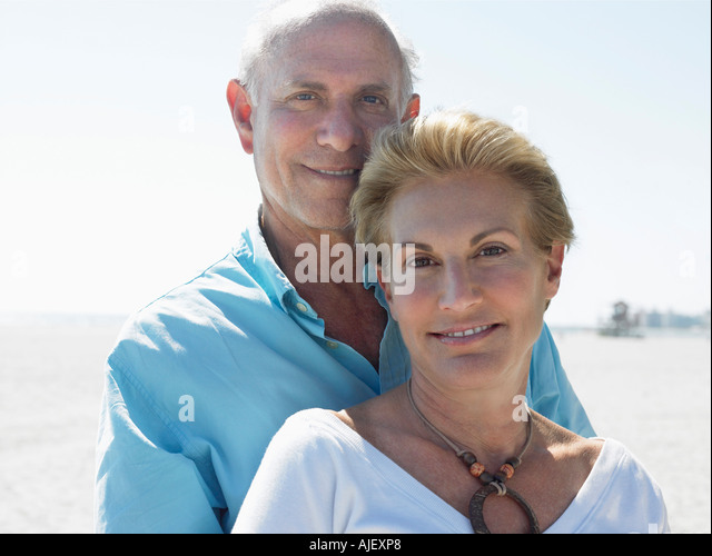 Senior couple on tropical  beach, close up - Stock Image