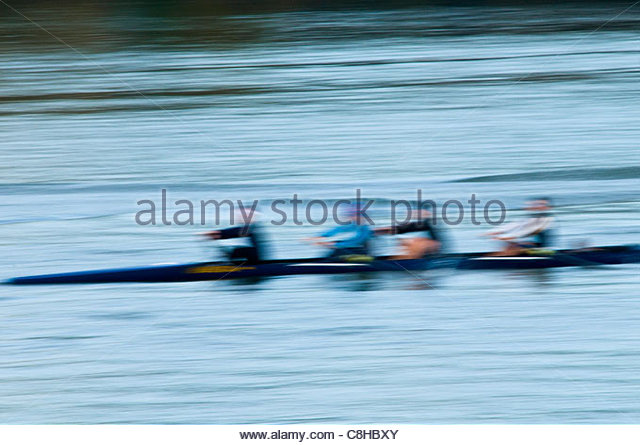 A crew practices rowing on a cold winter day on the Potomac River. - Stock Image