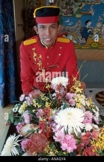 Bahamas Atlantic Ocean Holland America Line ms Maasdam cruise ship Asian porter flowers uniform man male - Stock Image