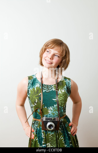 Young woman with an old vintage camera - Stock Image