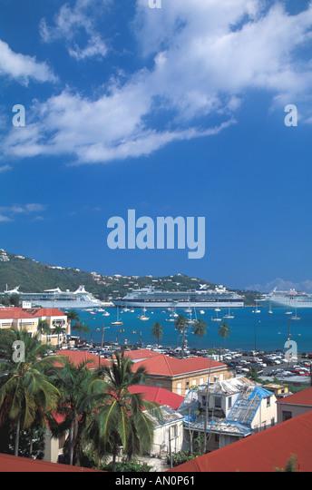 St Thomas USVI  US United States Virgin Islands charlotte amalie harbor cruise ships sailboats hillside caribbean - Stock Image
