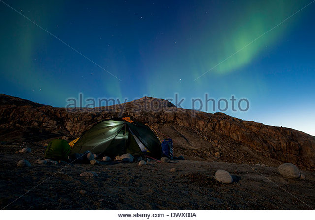 Tent with northern green lights at night - Stock Image