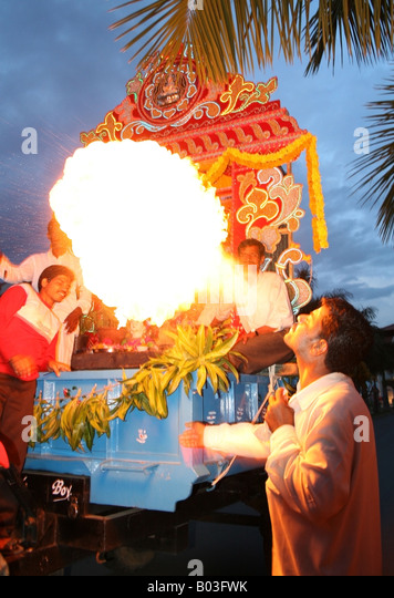 fire breather in front of a giant Ganesh float , Ganesh Chaturthi festival , India - Stock-Bilder