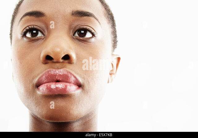 Close up studio portrait of sad young woman - Stock Image