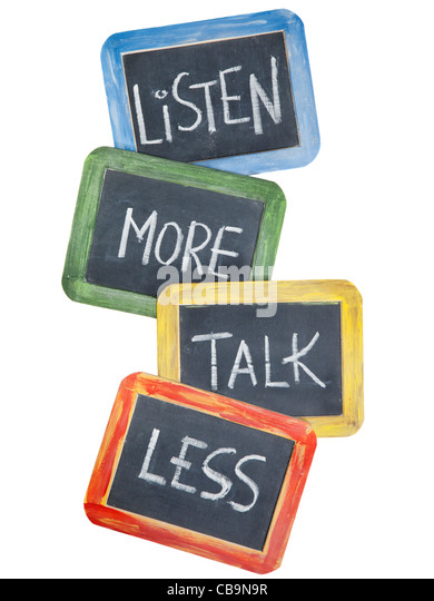 listen more, talk less - communication concept or advice - white chalk handwriting on small slate blackboards, isolated - Stock Image