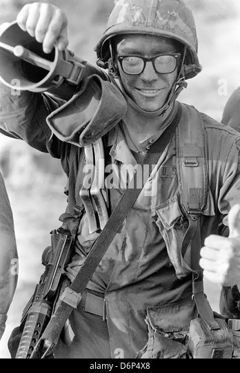 A US infantryman carries a 90mm M67 recoilless rifle during the Invasion of Grenada, codenamed Operation Urgent - Stock Image