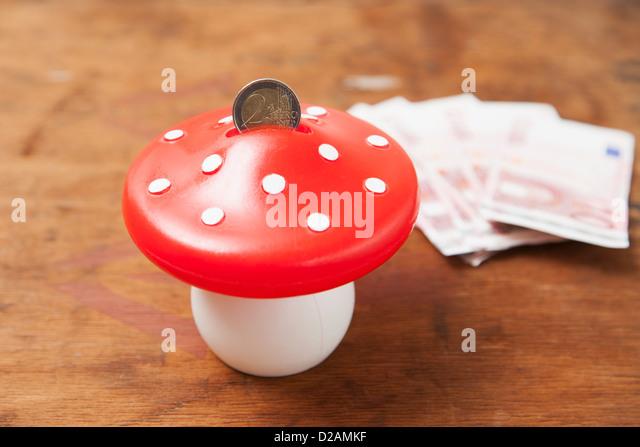 Close up of mushroom savings bank - Stock Image