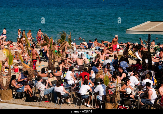 Spain Barcelona beach Platja de la Barceloneta people beach bar - Stock Image