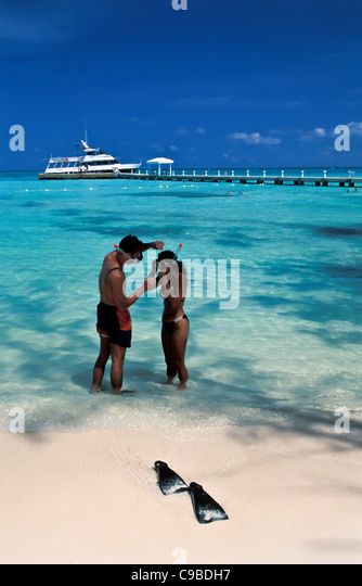 Grand Cayman Island, couple snorkeling at Rum Point - Stock Image