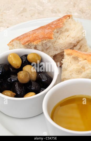 Olives, olive oil and bread - Stock-Bilder