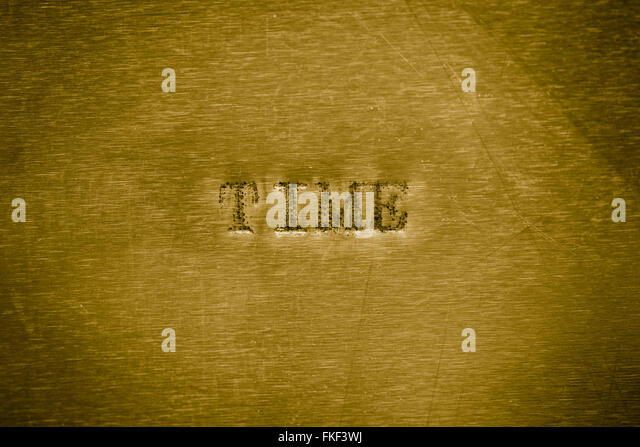 word time printed on  golden metallic background texture - Stock-Bilder
