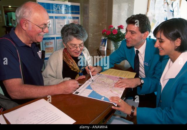 Portugal Monte Estoril Hotel Atlantico Saga Holidays tour guide senior couple map help information - Stock Image
