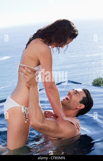 Portrait of a joyful couple relaxing - Stock Image